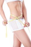 Woman measuring waist of perfect body Royalty Free Stock Images