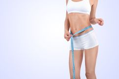 Woman measuring waist of perfect body Stock Image