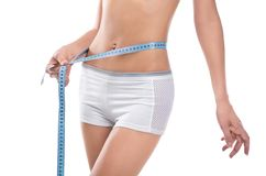 Woman measuring waist of perfect body Stock Photography