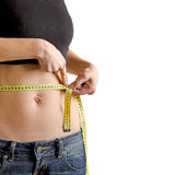 Woman measuring waistline with a tape Royalty Free Stock Photography