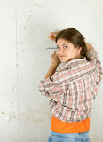 Woman measuring  wall Stock Photos