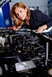 Woman at the mechanic Royalty Free Stock Photography
