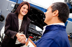Woman at the mechanic Royalty Free Stock Image