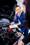 Woman at the mechanic Stock Photography