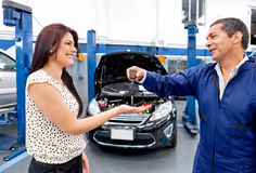 Woman at the mechanic Stock Images