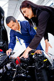 Woman at the mechanic Royalty Free Stock Images