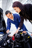 Woman at the mechanic Stock Photo
