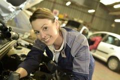 Woman mechanic checking car reparation Royalty Free Stock Image