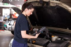 Woman Mechanic with Diagnostics Tool Royalty Free Stock Images