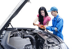 Woman with mechanic looking at clipboard Royalty Free Stock Images