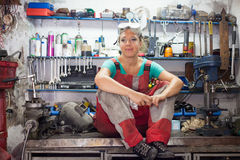 Woman mechanic posing in a workshop Stock Photo