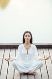 Woman mediating. Stock Photos