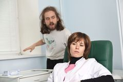 Woman medic and funky patient in her office Royalty Free Stock Photos