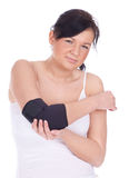 Woman in medical bandage, elbow support Stock Photo