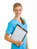 Woman in medical doctor uniform holding clipboard Royalty Free Stock Images