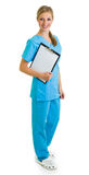Woman in medical doctor uniform holding clipboard Royalty Free Stock Image