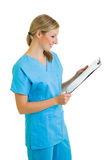 Woman in medical doctor uniform holding clipboard Royalty Free Stock Photography