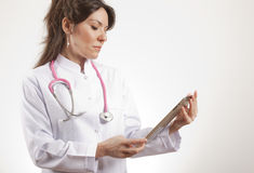 Woman Medical doctor using tablet Stock Photography