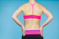 Woman with medical kinesio taping on back Stock Images