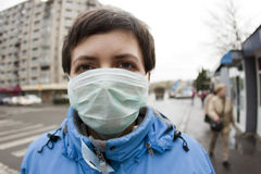 Woman with medical mask. In the street Royalty Free Stock Images