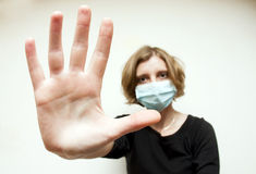 Woman with medical mask. In the street Stock Photos