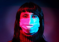 Woman in a medical mask. On abstract color background Royalty Free Stock Photo