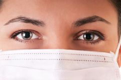 Woman in medical mask. Woman in white medical mask. Selective focus on eyes Stock Images