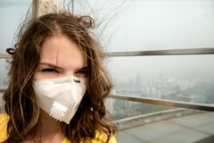 Woman in medical mask against the air pollution. Close-up Stock Images