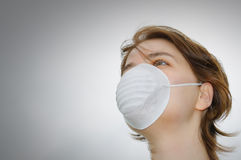 Woman with medical mask and copy space. Woman wears protective mask against flu or pollution Royalty Free Stock Images