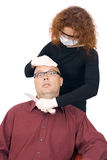 Woman in medical mask cutting throat man Royalty Free Stock Image