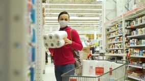 Woman in Medical Mask Shopping for Toilet Paper