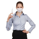 Woman in medical mask with syringe. Strict woman in medical mask with syringe Royalty Free Stock Photos