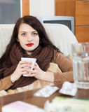 Woman with medications at living room Royalty Free Stock Images