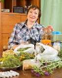 Woman with medicinal herbs Royalty Free Stock Photos