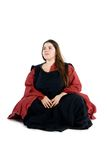 Woman in a medieval dress. An isolated photo of a woman in a fancy medieval dress Royalty Free Stock Image