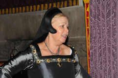 Woman in medieval dress Stock Images