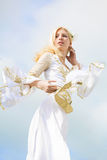 Woman in the medieval dress. Young woman runs in the white medieval dress Stock Image