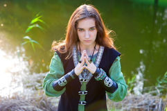 Woman in medieval suit with folded hands royalty free stock photography