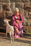 Woman in medieval suit with nanny goat Stock Images