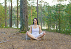 Woman meditate in the forest Stock Image