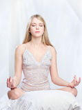 Woman meditate at home Stock Photos