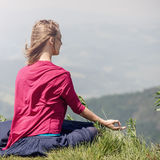 Woman Meditate at the Mountains stock photos