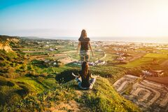 Free Woman Meditates On The Top Of The Mountain. Soul Leaves Body. Mind And Spirit Royalty Free Stock Photo - 216960725