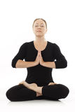 Woman meditating. Woman doing yoga exercise on white background Stock Images