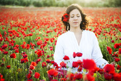 Woman meditating. Young beautiful woman meditating in spring field Stock Image