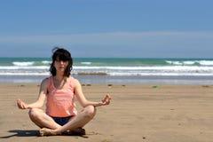 Woman meditating. At the sea shore Stock Image
