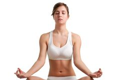 Woman Meditating. Woman doing yoga isolated on a white background Stock Photo