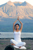 Woman Meditating. By a mountain Royalty Free Stock Images