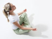 Woman meditating. Above view of fit woman sitting and meditating Stock Photo