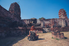 Woman meditating in ancient ruins Stock Images